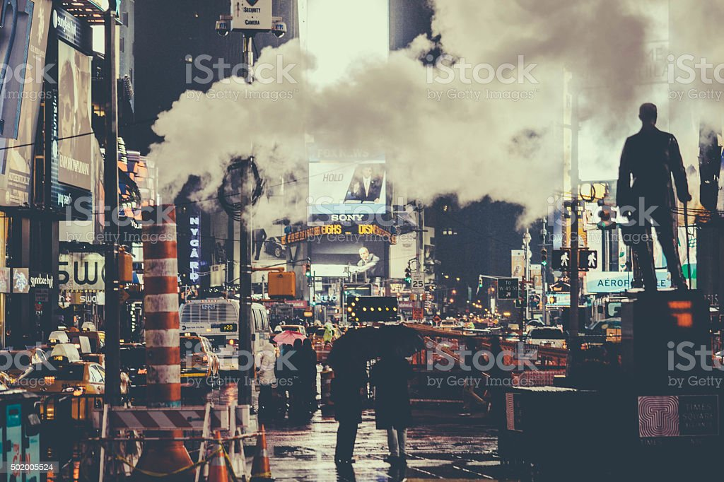 Smoke rises in Times Square, NYC. Late night. stock photo