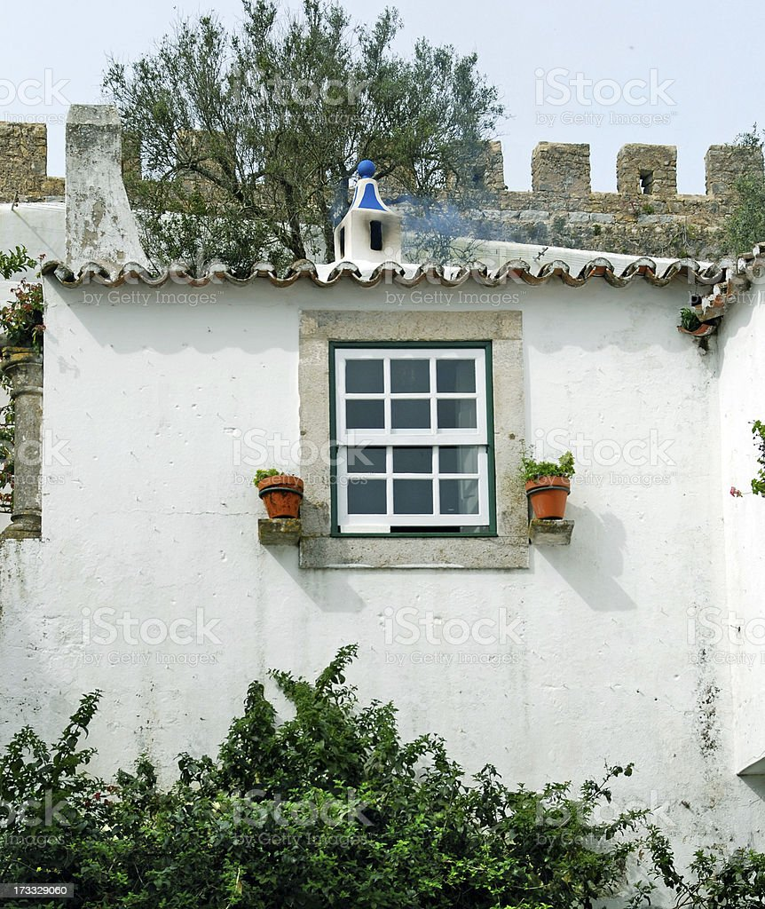 Smoke rising from a cottage's chimney in Portugal stock photo