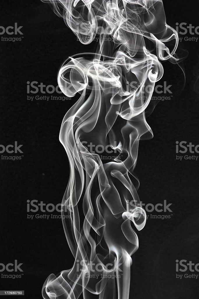 Smoke rising on a black background royalty-free stock photo