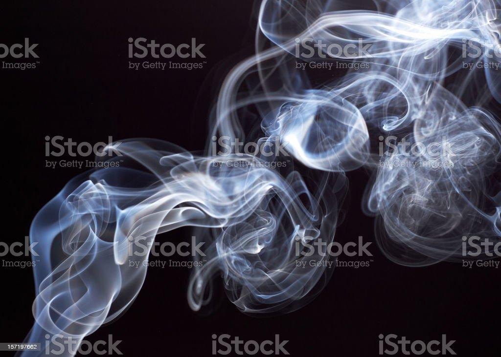 Smoke rising with black background stock photo