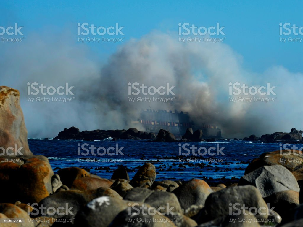 Smoke settles after ship explodes stock photo