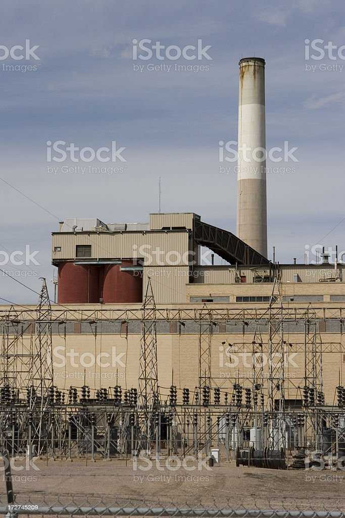 Smoke stack, electric lines and power plant in Denver, Colorado royalty-free stock photo