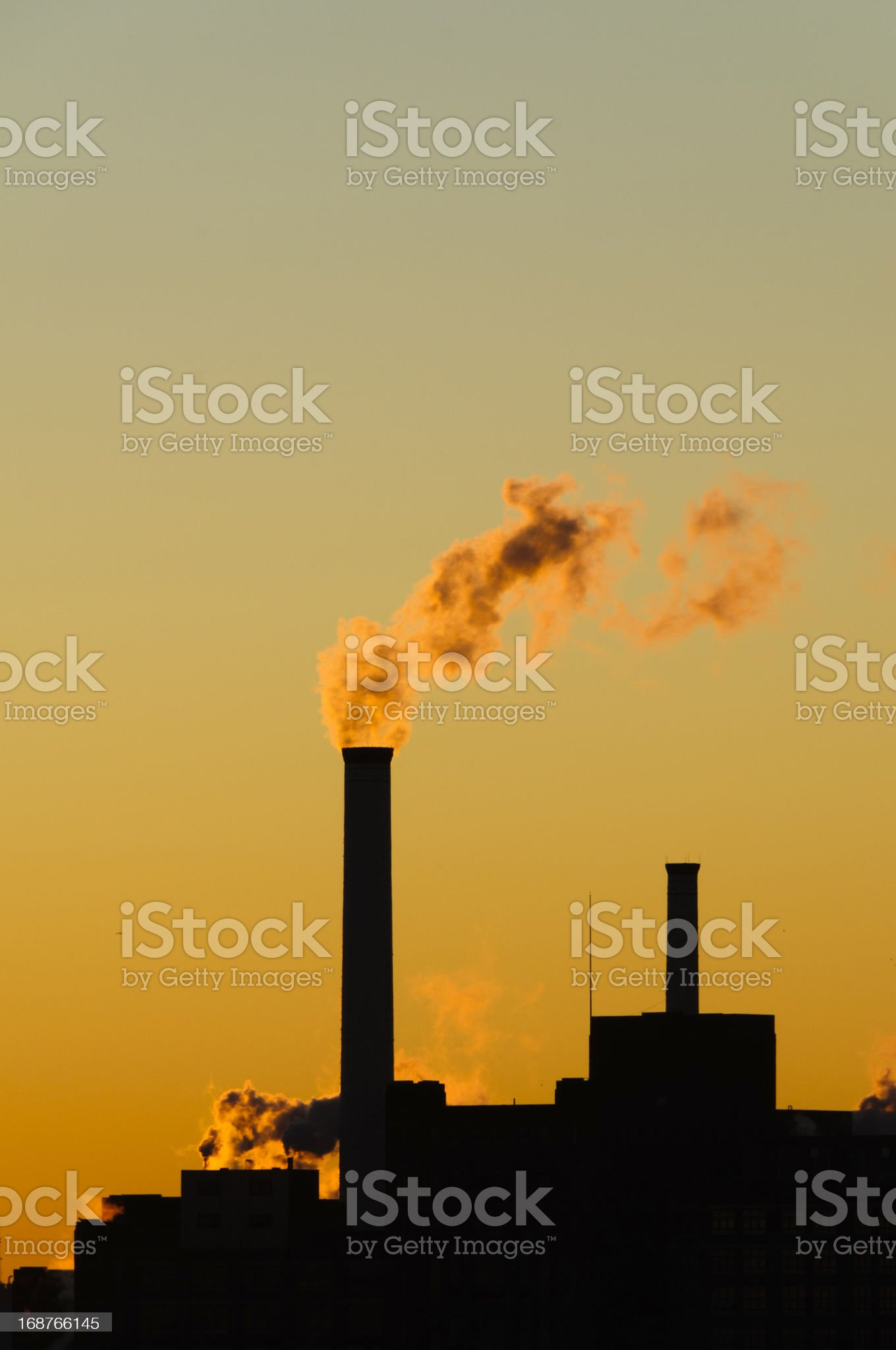 Smoke stack in the early morning royalty-free stock photo