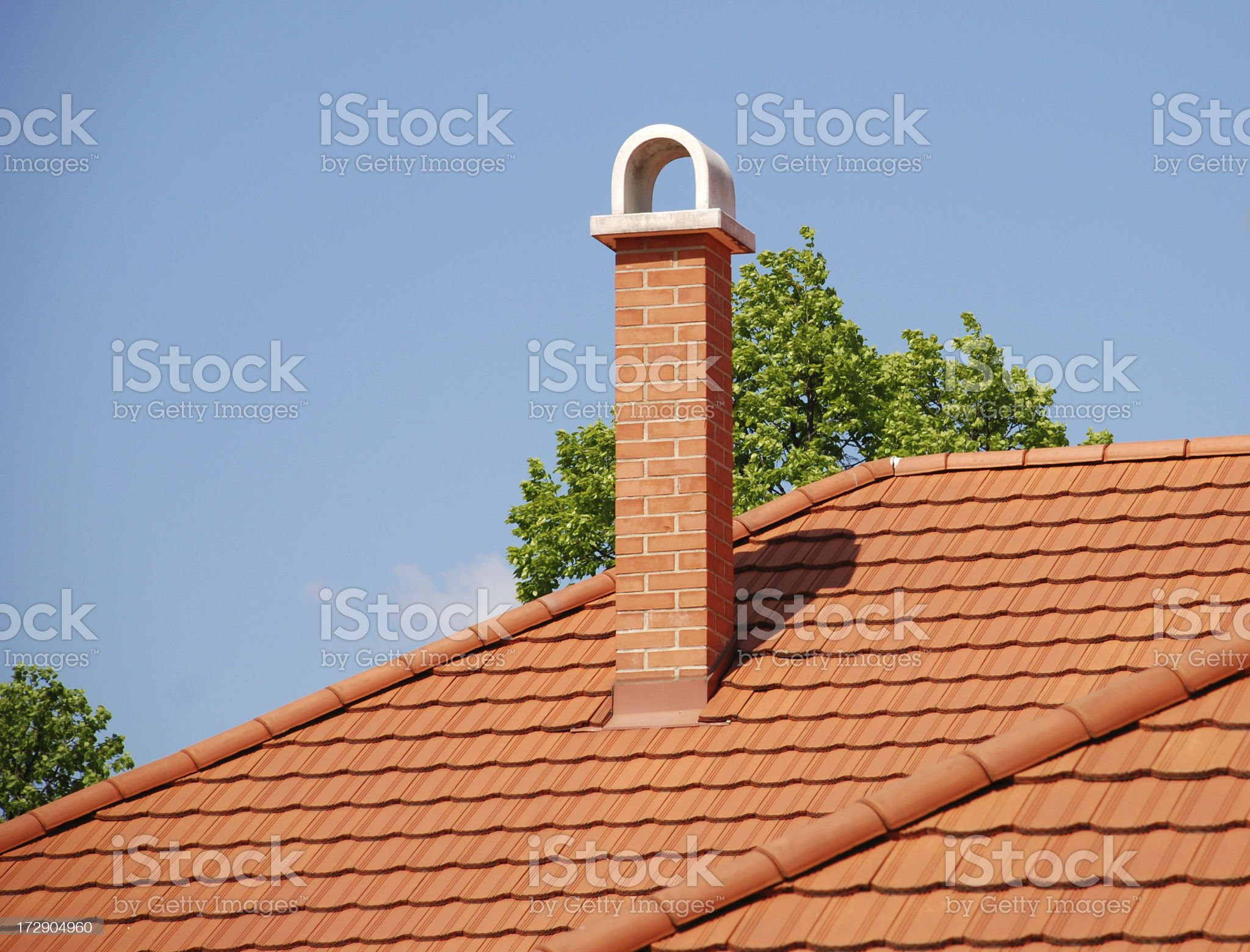 smoke stack on the roof royalty-free stock photo
