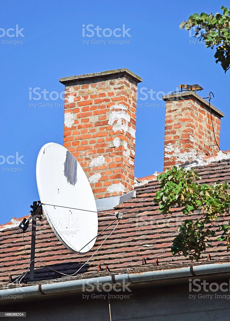Smoke stacks and antenna on the roof stock photo