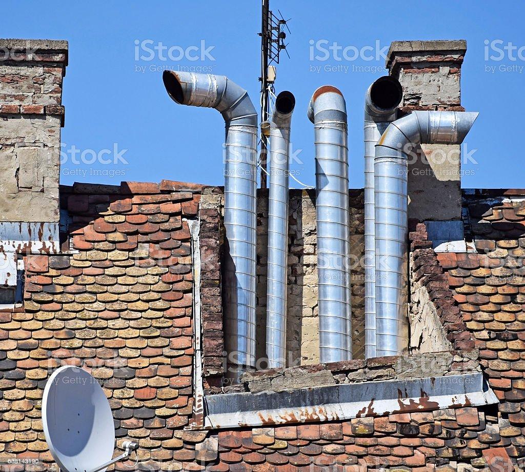 Smoke stacks on the roof stock photo