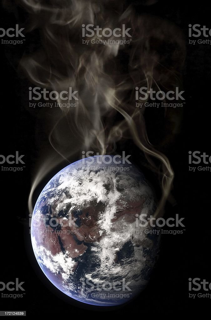 Smoke surrounding the earth in global warming concept stock photo