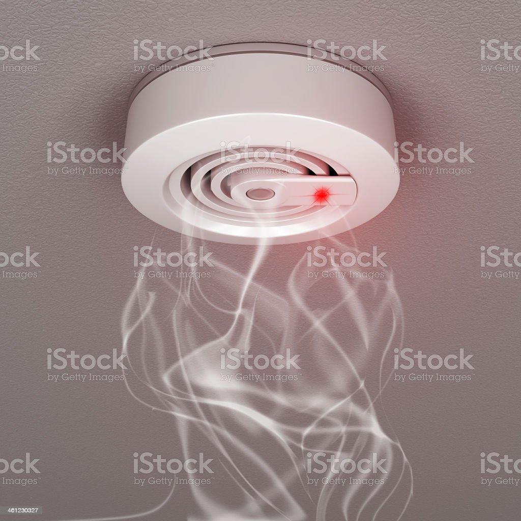 Smoke wafting into fire detector or smoke alarm stock photo
