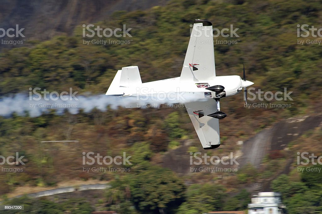 Smoke White Airplane in motion royalty-free stock photo