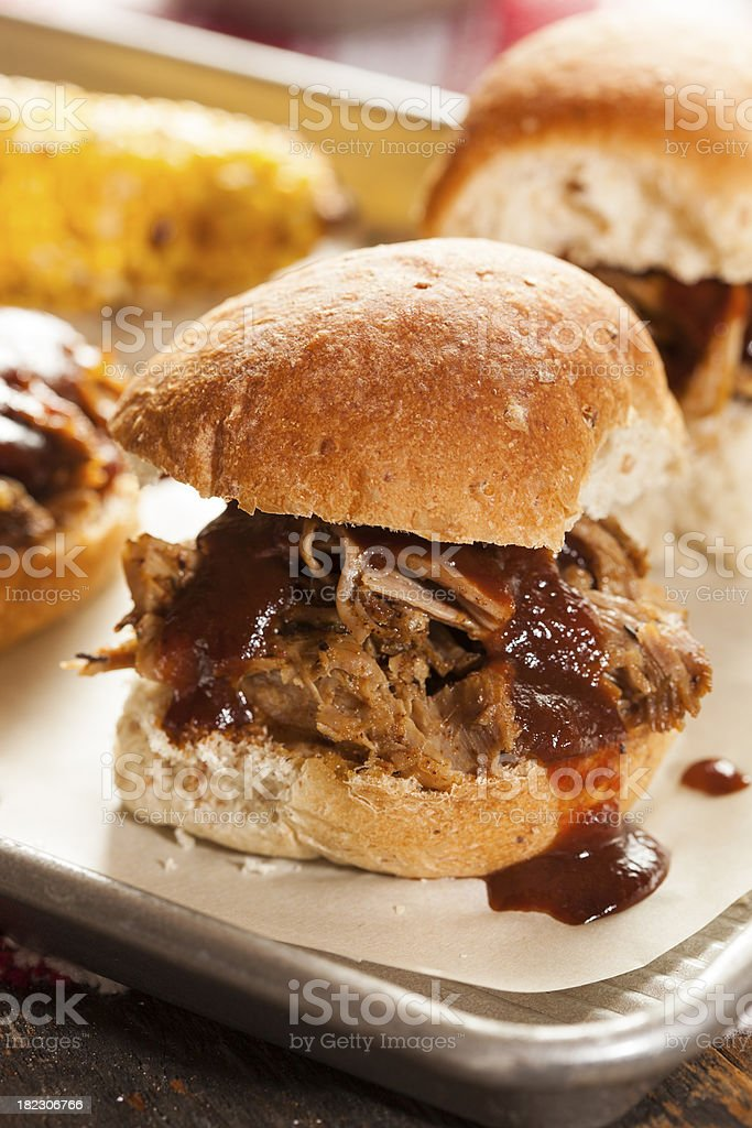 Smoked barbecue pulled pork sliders on metal tray stock photo
