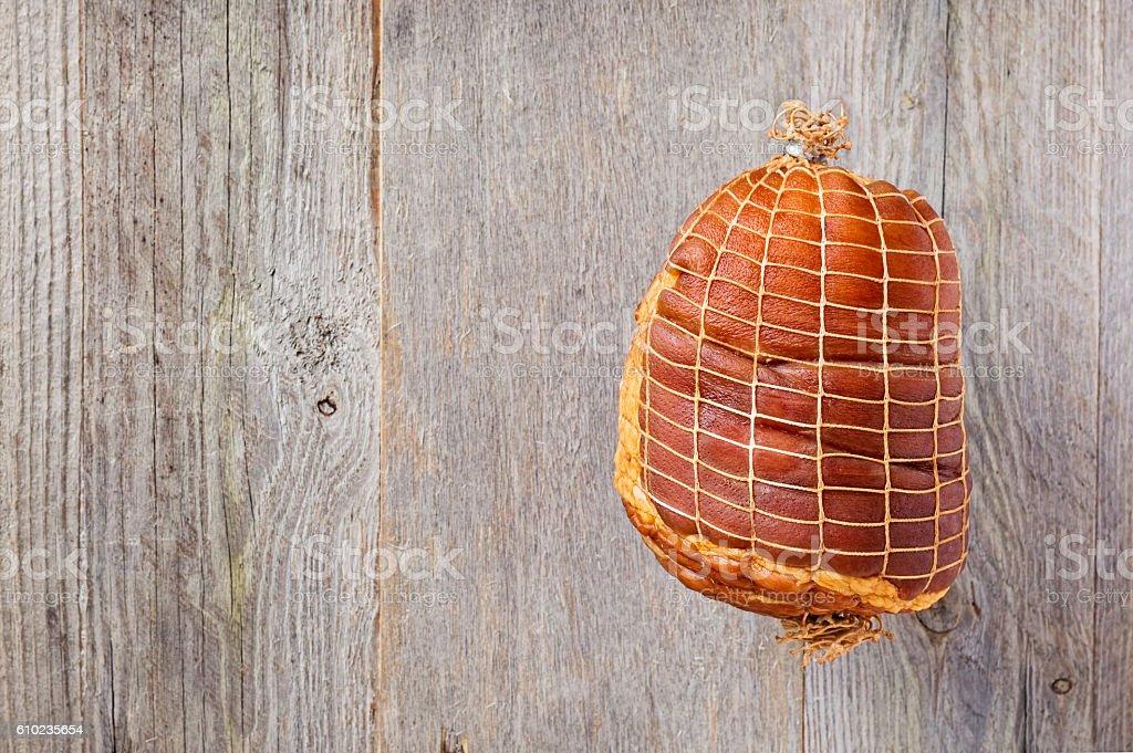 Smoked Boneless Ham Hock Wrapped in Netting stock photo