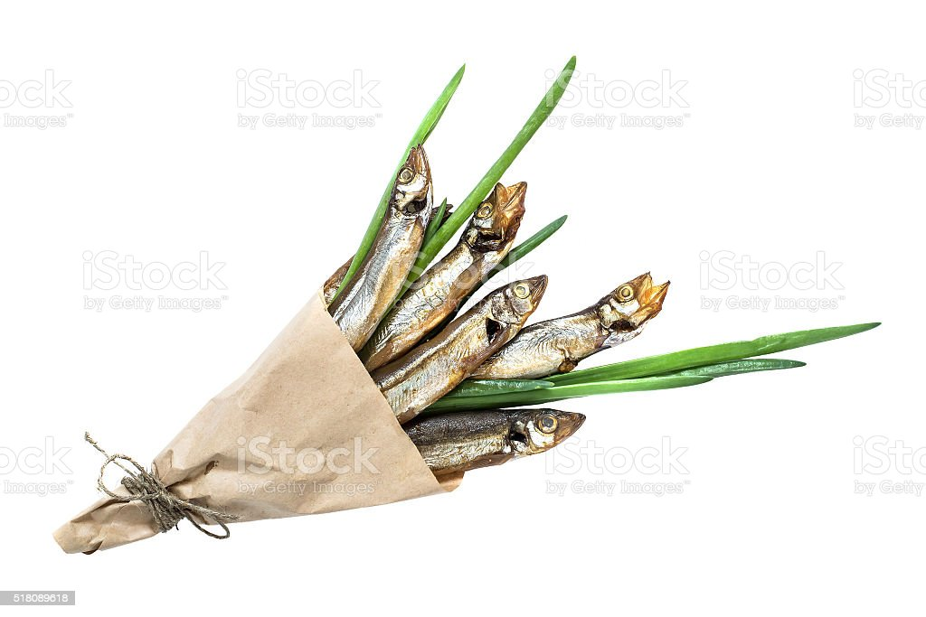 Smoked capelin with green onions in paper cornet stock photo