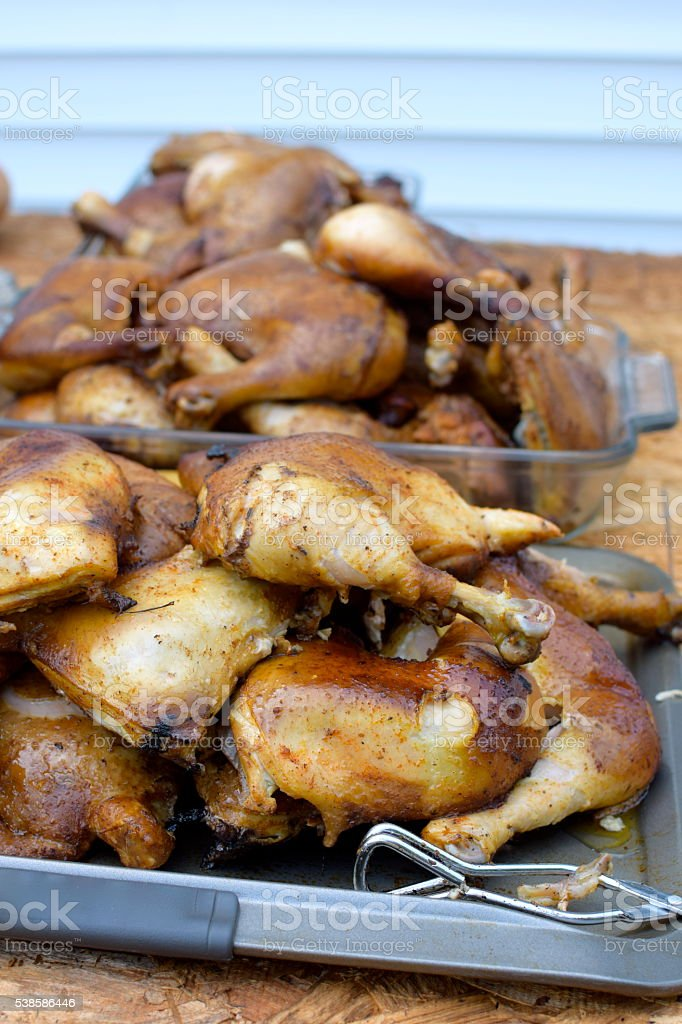 Smoked Chicken Quarters stock photo