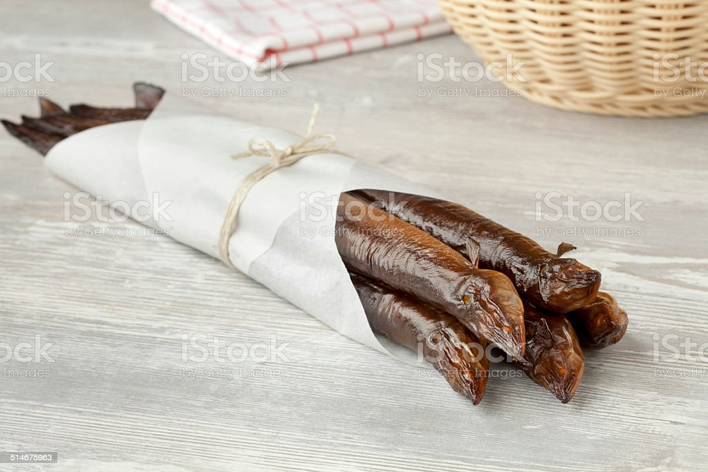 Smoked eels wrapped in paper stock photo