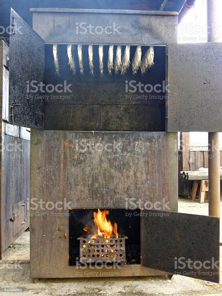 smoked fish in oven stock photo