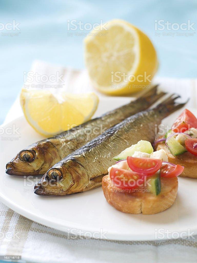 Smoked fish with bruschetta royalty-free stock photo