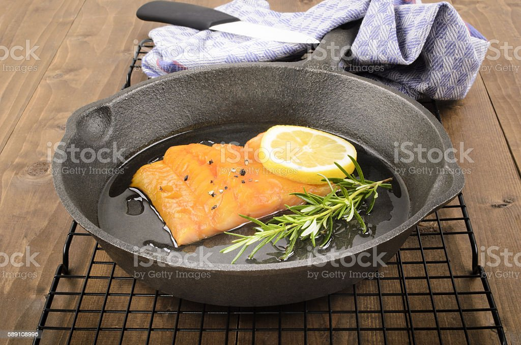 smoked haddock with rosemary and a lemon slice stock photo