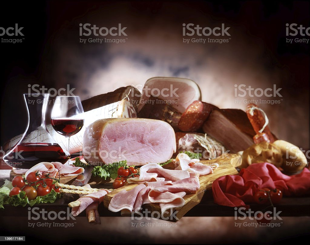 Smoked ham, sausages and wine royalty-free stock photo