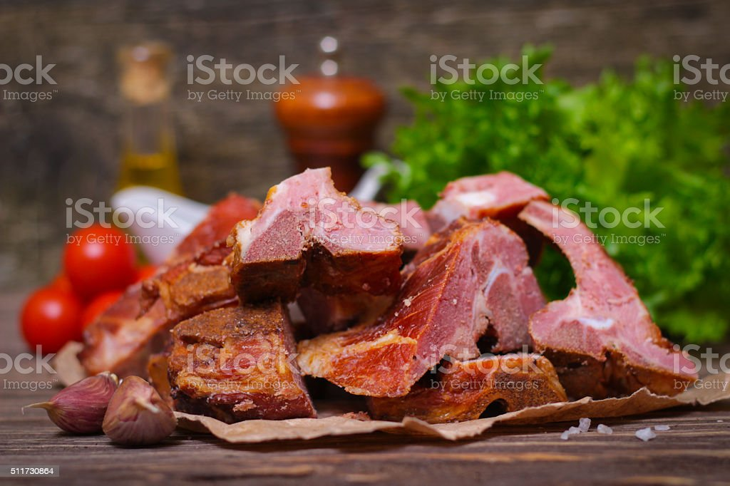 Smoked pork meat on the bone with vegetables stock photo