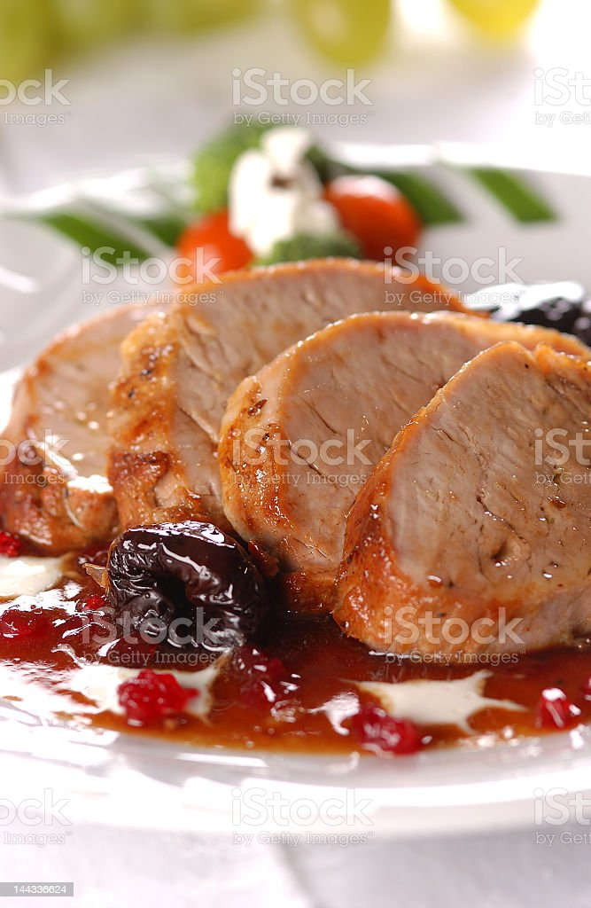 Smoked pork with cherry sauce and vegetables stock photo