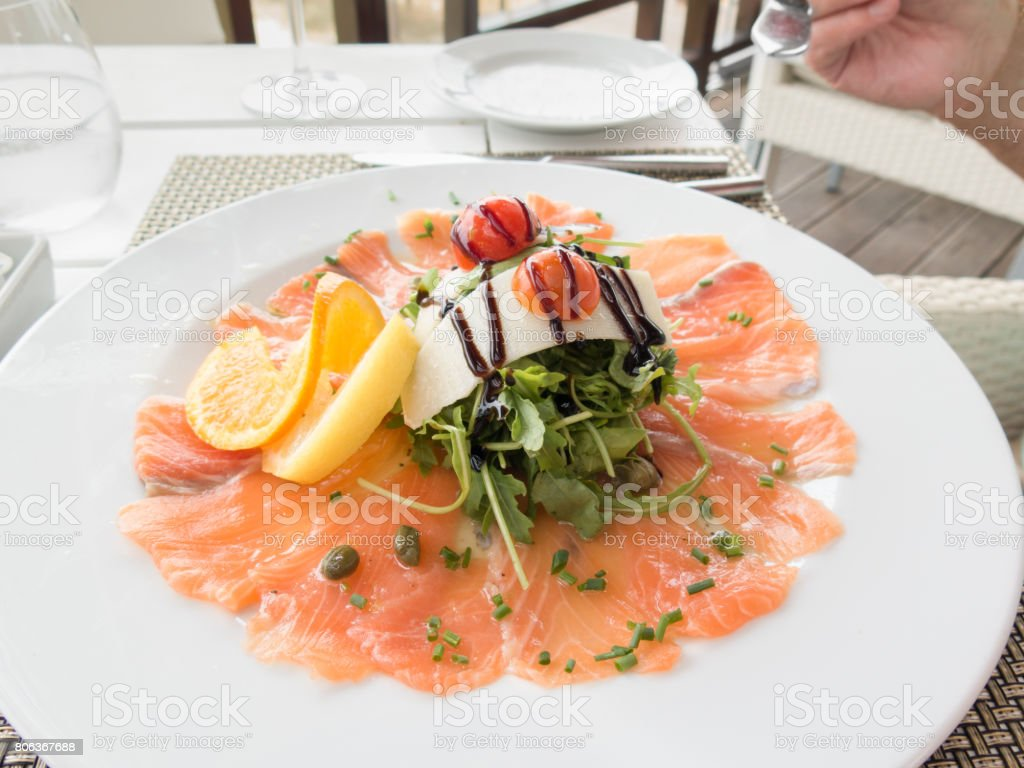 smoked salmon and green leaf salad stock photo