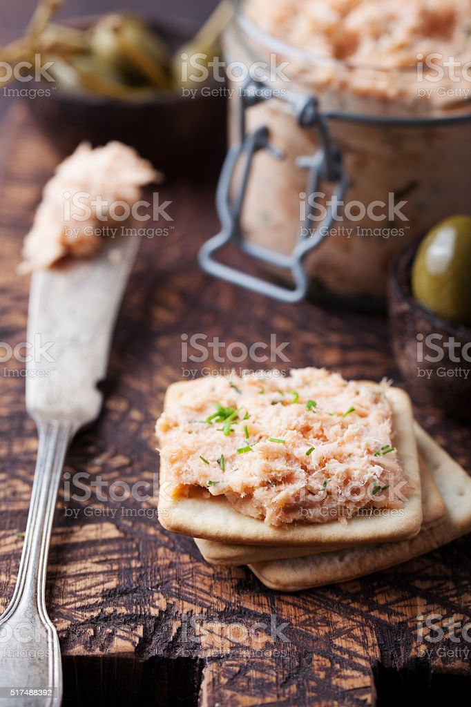 Smoked salmon and soft cheese spread, mousse, pate with crackers stock photo