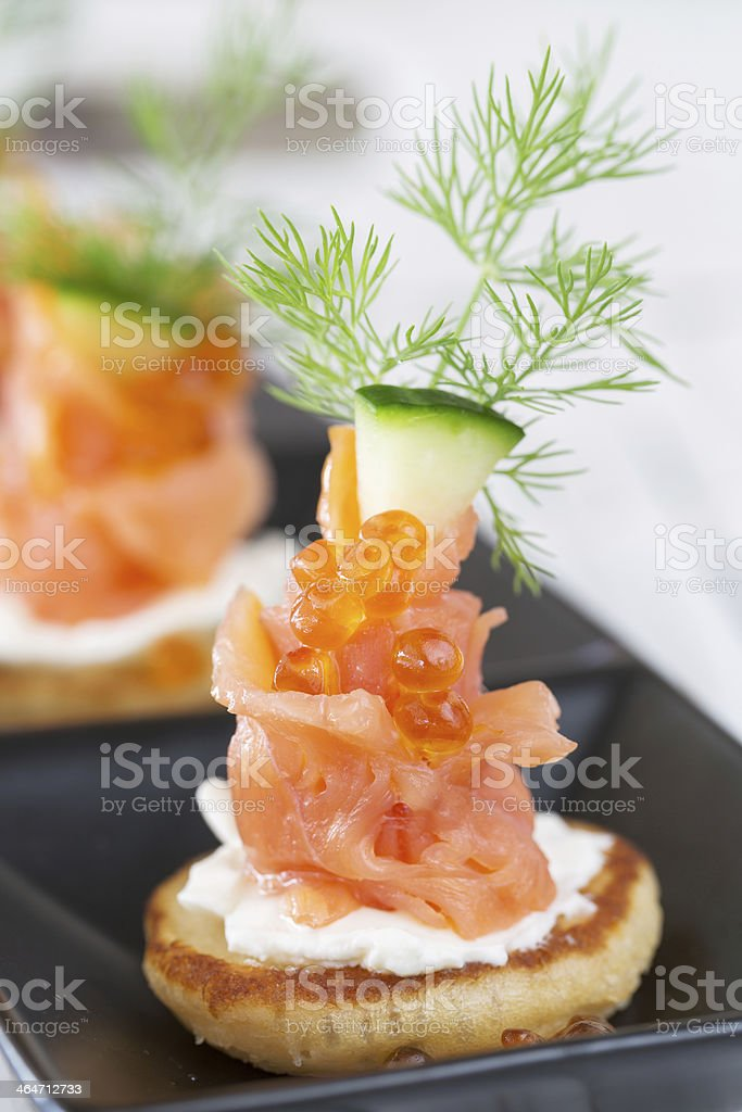 Smoked salmon and sour cream appetiser, garnished with dill stock photo