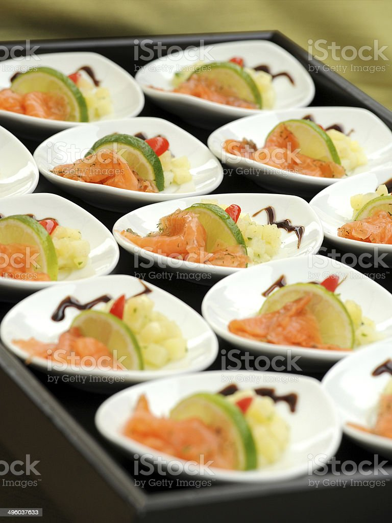 Smoked salmon appetizers on a buffet table stock photo