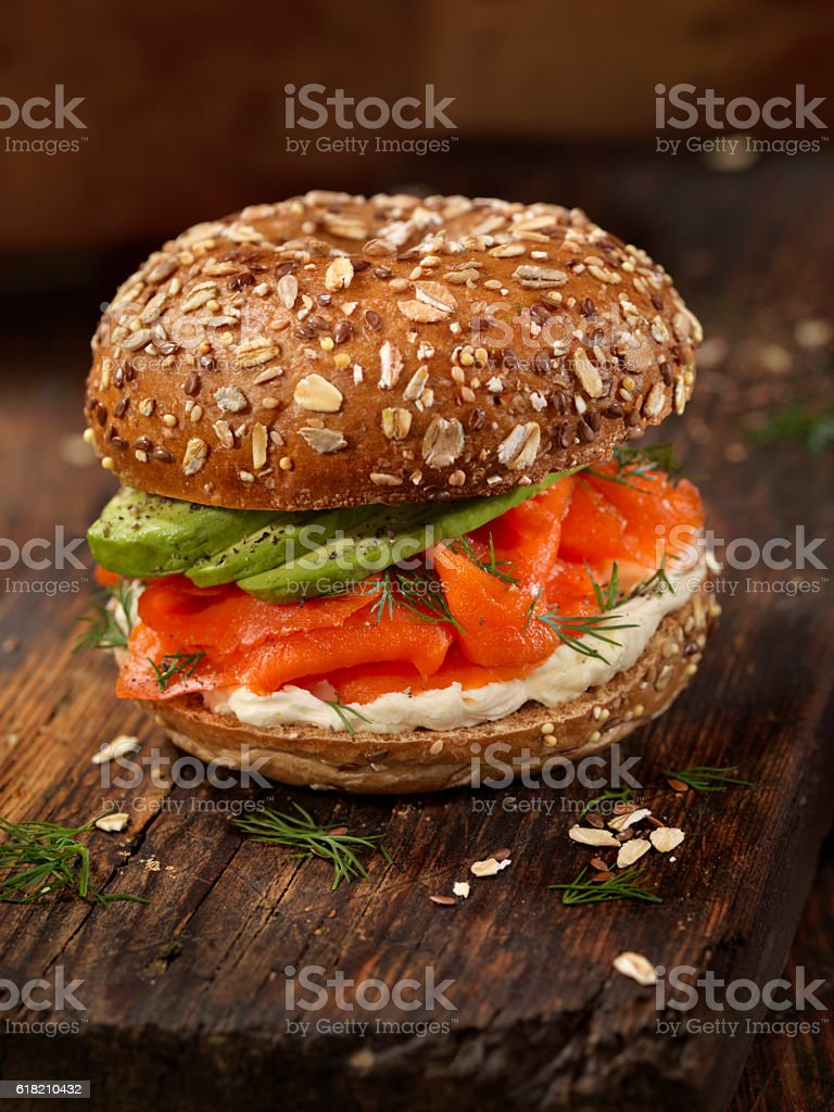 Smoked Salmon Bagel with Cream Cheese and Avocado stock photo