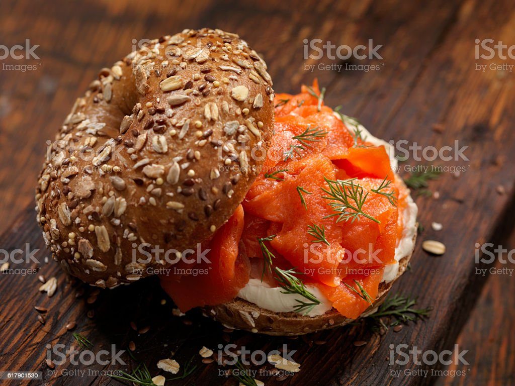 Smoked Salmon Bagel with Cream Cheese and Fresh Dill stock photo