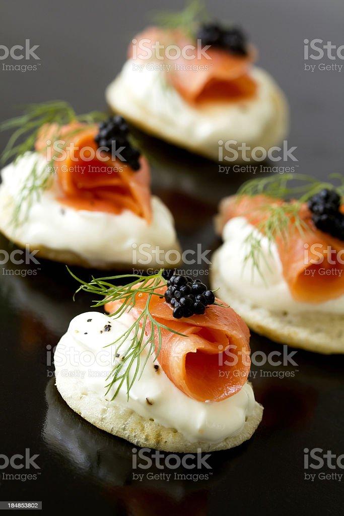 Smoked salmon blinis stock photo