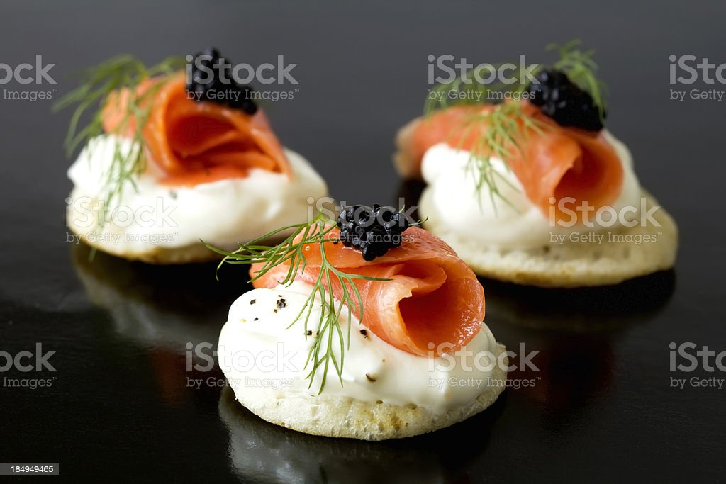 Smoked salmon blinis stock photo