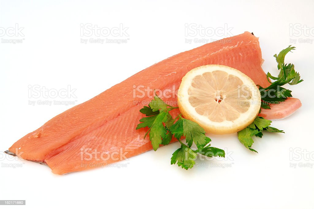 Smoked salmon filet with sliced lemon and parsley royalty-free stock photo