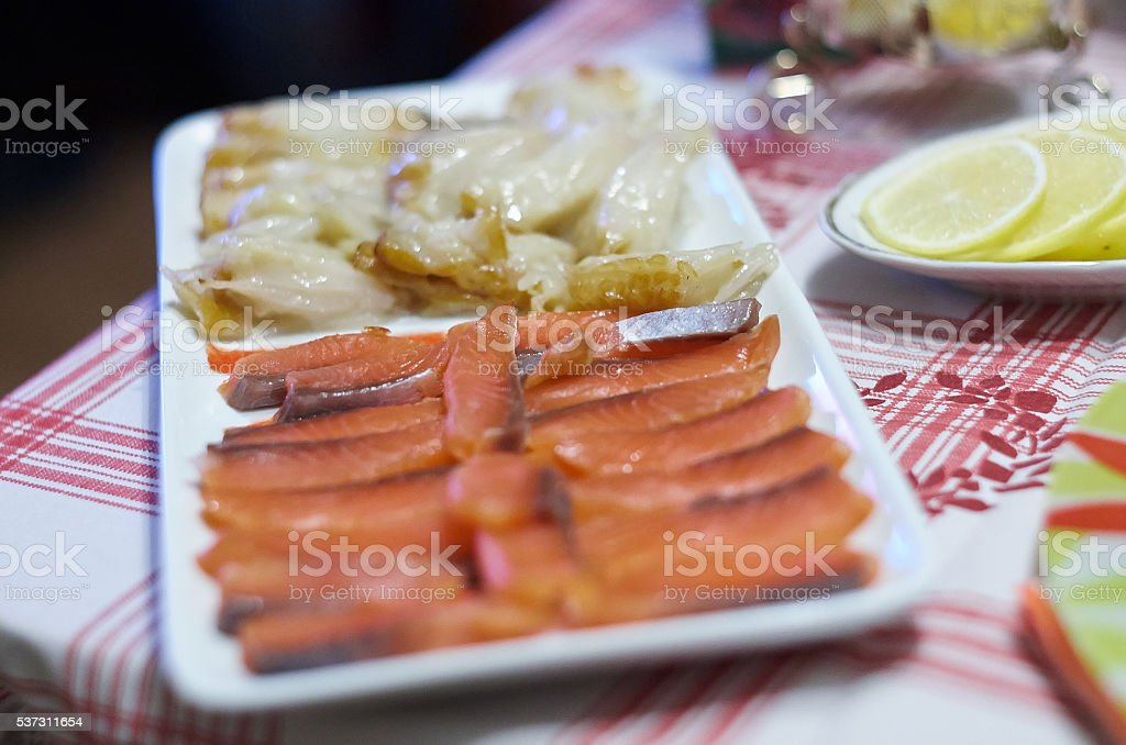 Smoked salmon, halibut on a dinner table. Cold fish cuts stock photo