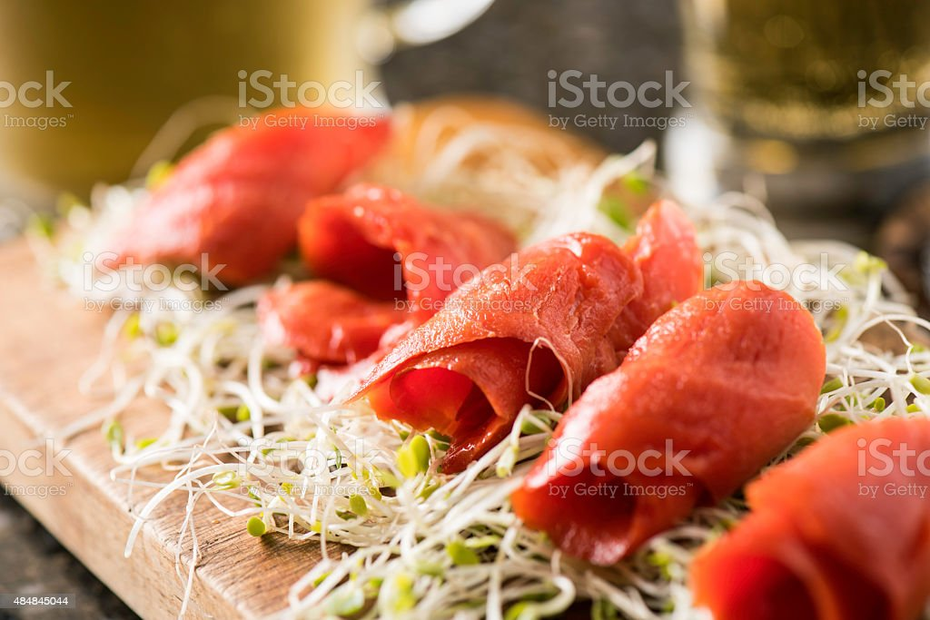 Smoked Salmon on a bed of fresh sprout stock photo