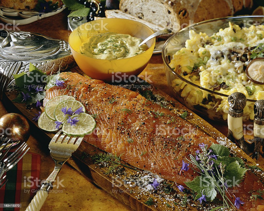 Smoked salmon on cutting board stock photo