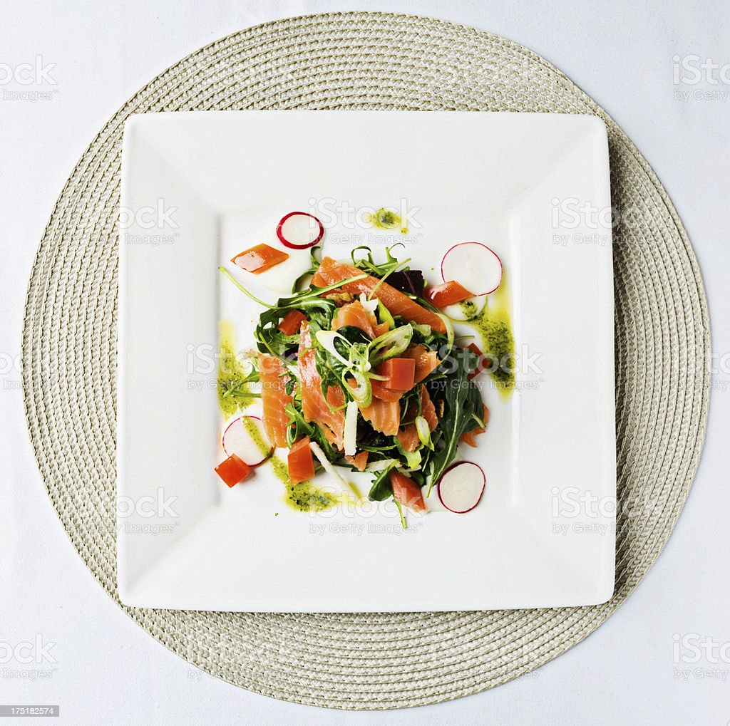 Smoked salmon salad on square plate seen from above stock photo