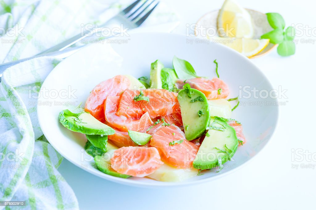Smoked salmon salad with avocado and potato stock photo