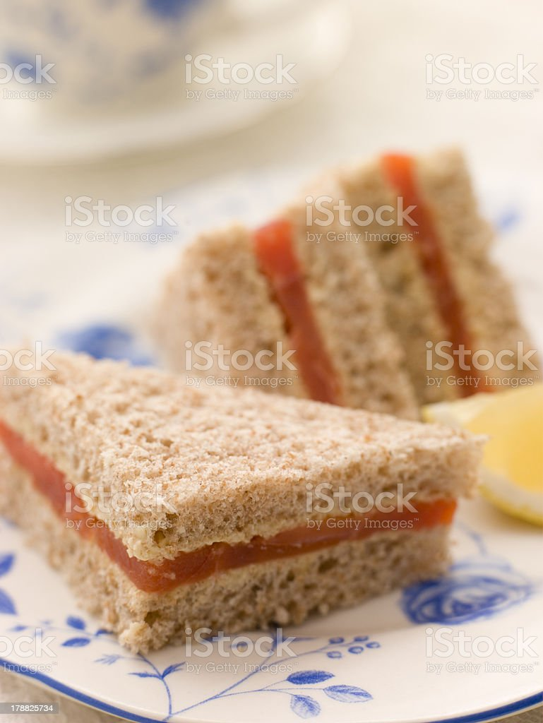 Smoked Salmon Sandwich on Brown Bread with Afternoon Tea royalty-free stock photo