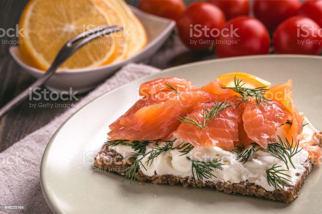 Smoked salmon sandwich with cream cheese stock photo