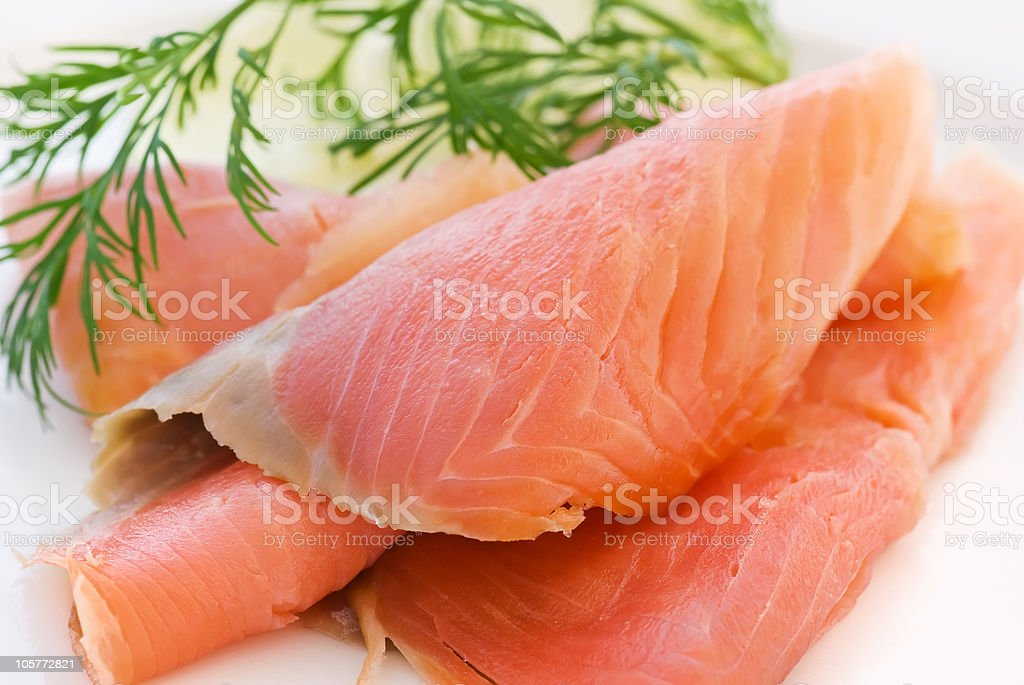 Smoked salmon with leaves for seasoning royalty-free stock photo
