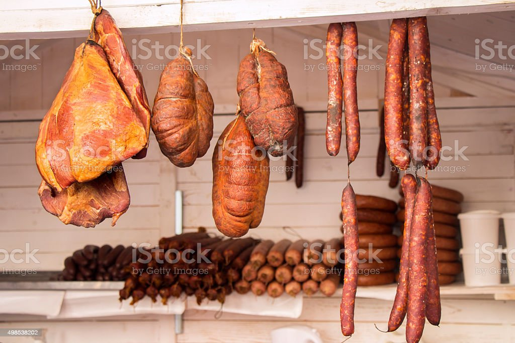 Smoked Sausage and Bacon in a street market stock photo