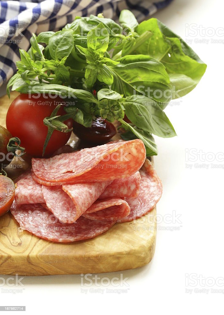 smoked sausage, tomatoes and basil royalty-free stock photo