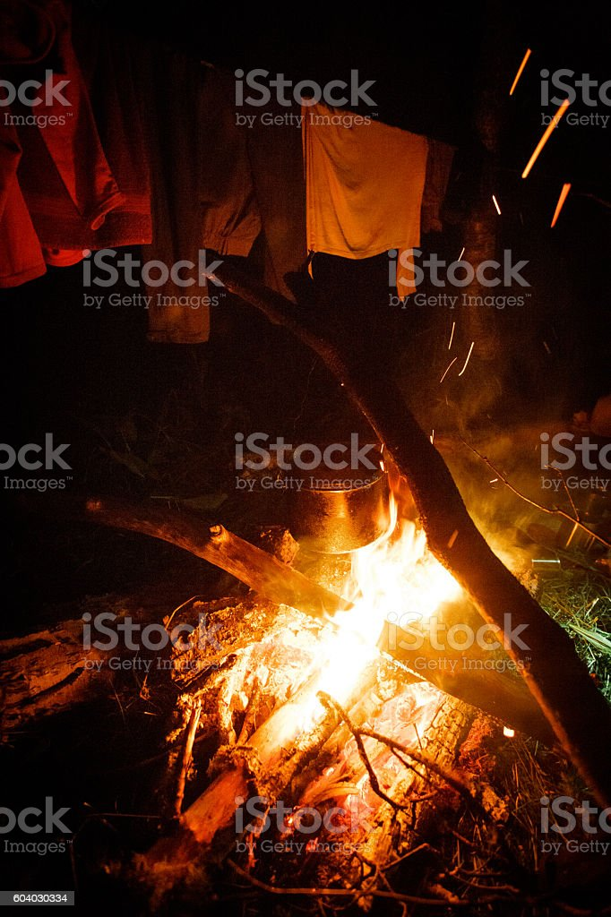 Smoked tourist kettle over camp fire in the evening royalty-free stock photo