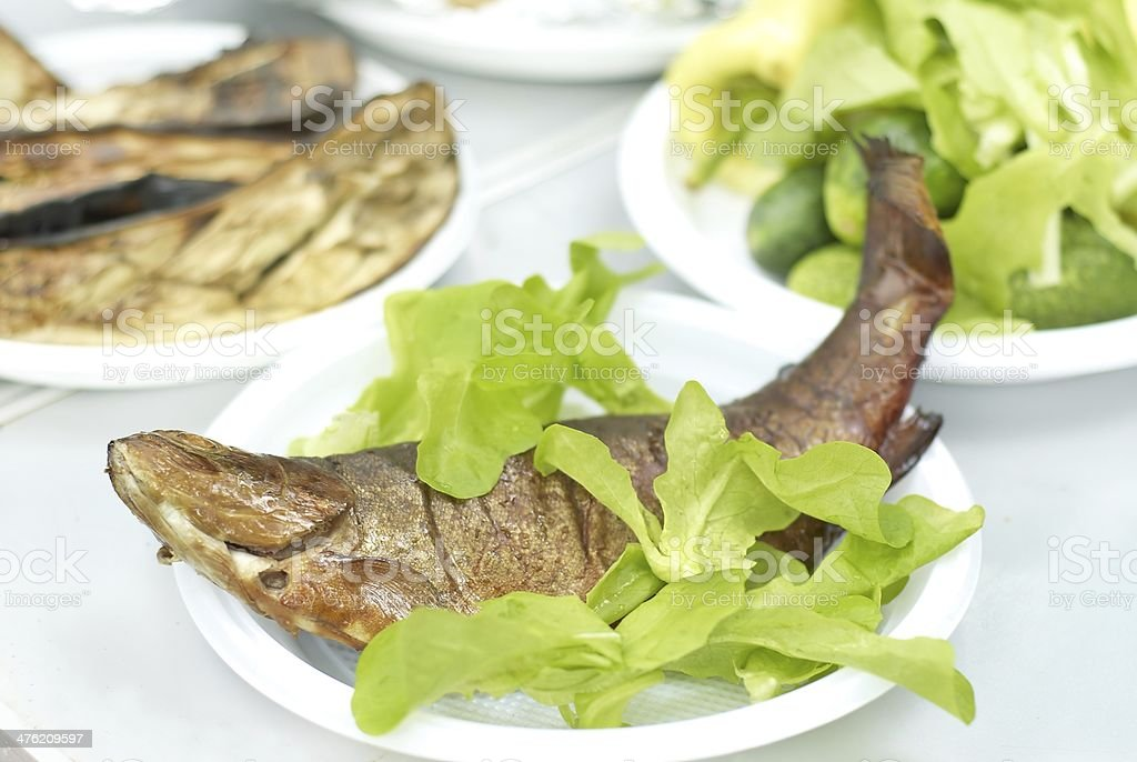 Smoked trout with green salad royalty-free stock photo