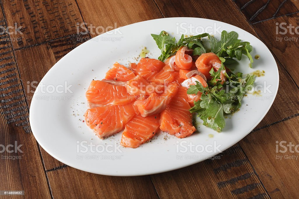 Smoked trout with greens stock photo