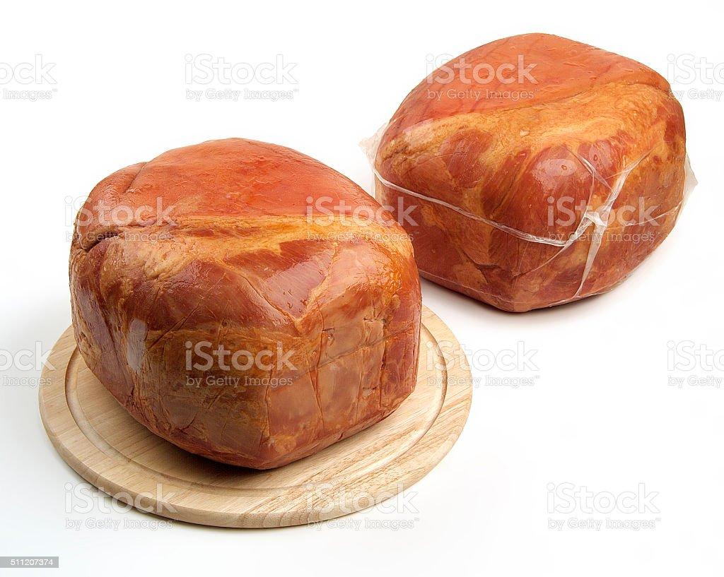Smoked whole ham on cutting board stock photo