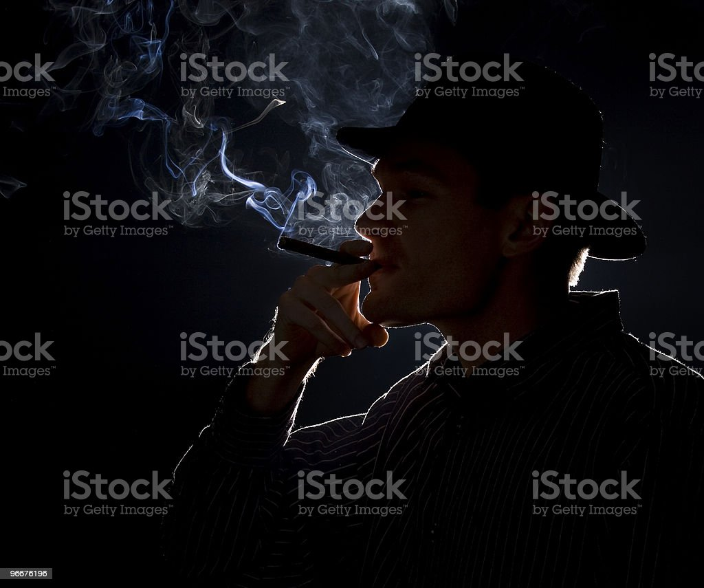 Smoker Silhouette of a mobster stock photo