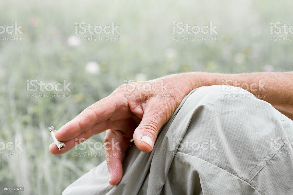 Smoker's hand stock photo