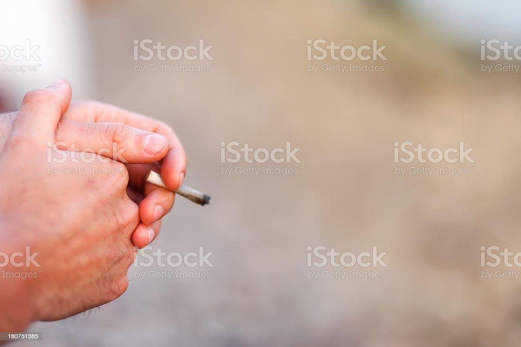 Smokers hands stock photo